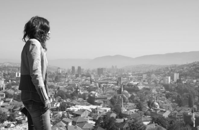 Young woman overlooking Sarajevo from Zuta Tabija.