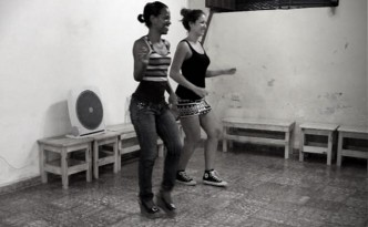 Two young women practicing Cuban salsa