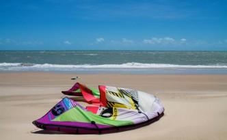 North kite lying on beach in Cumbuco, Brazil